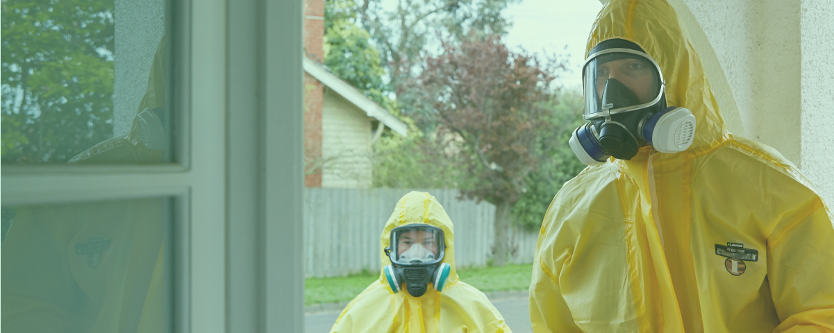 Two mould removal technicians in hazmat suits